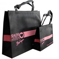 Buy cheap 120gms Black Non Woven Carry Bag Silk Screen Printing Pink Logo for lady garment from wholesalers
